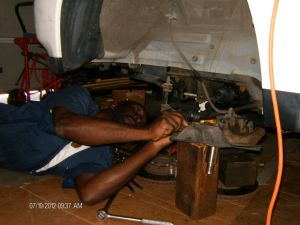 Howard making repairs to his 1995 Mazda MPVsummer 2012